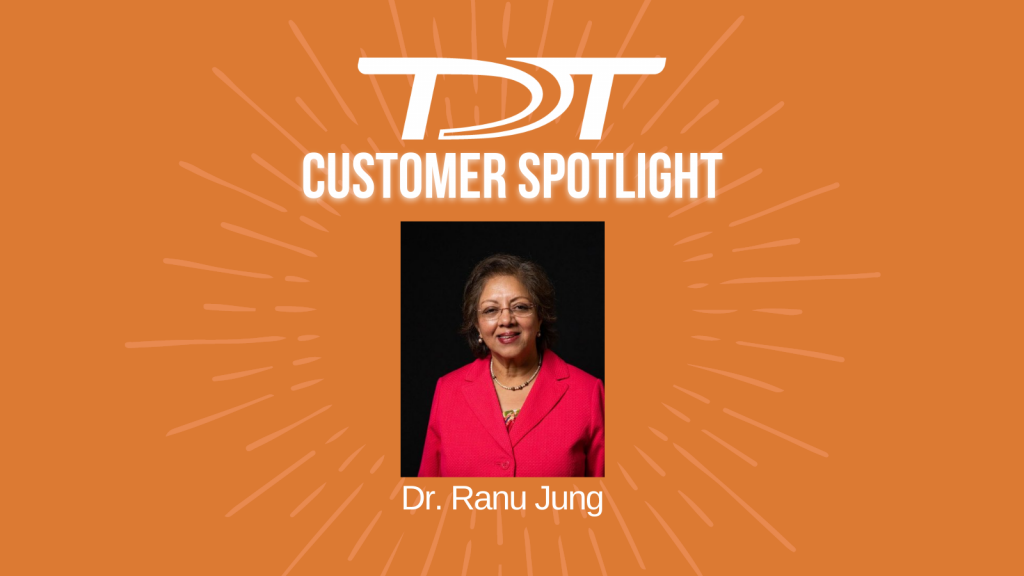 """Images of Dr. Jung on an orange starburst background with the text in white """"TDT Customer Spotlight"""" and her name underneath."""